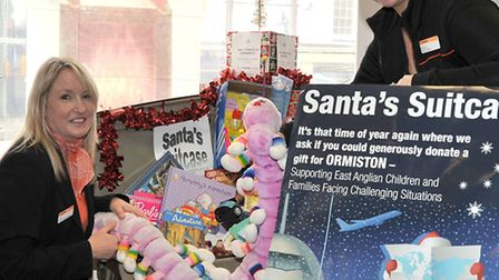 Santa's Suitcase at the Co-operative travel shop March. Left: Jane Savage and Natasha Thatcher.
