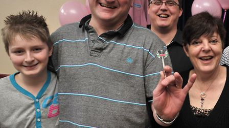 Mark Cross with family and friends at the first charity darts event in 2011.