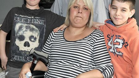 Elaine Nightingale- disabled mum of 2 needs to be rehoused. Left: Son Kyle, Dad Mark, son Reece and