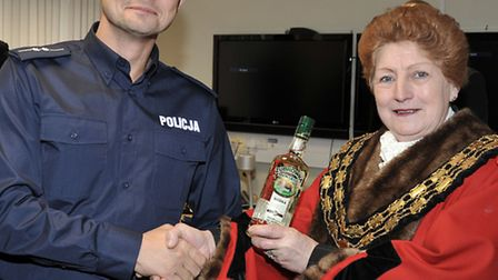 Four senior police officers from Poland, visiting Fenland. Marek Dzierzega presents the Mayor of Mar