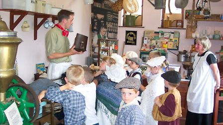 Children in costume at the the Farmland Museum shop.