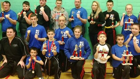 Martials arts stars from the BCKA show off their silverware after the first event in the Peterboroug