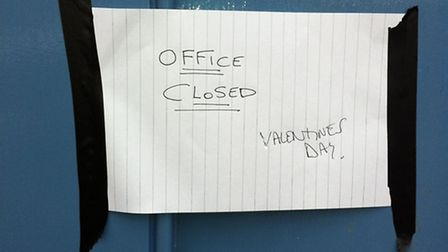 A sign says March train station ticket office was closed because of Valentine's Day