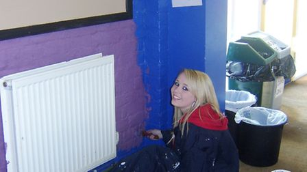 Charlie Manders helps paint the meeting room at Young People March.