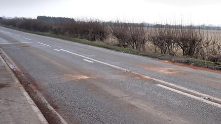 The site of the crash, in Eastrea Road, after the oil-spill was cleared.