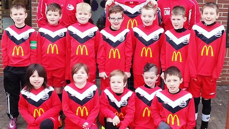 Tydd St Mary Under-10s are presented with their new kit by Richard Hyde from McDonald's, Long Sutton