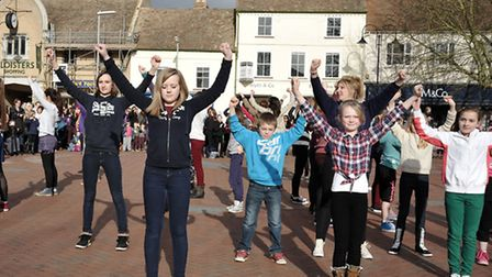 """Ely Youth Fair """"flash mob"""" and exhibitors at Paradise sports centre."""