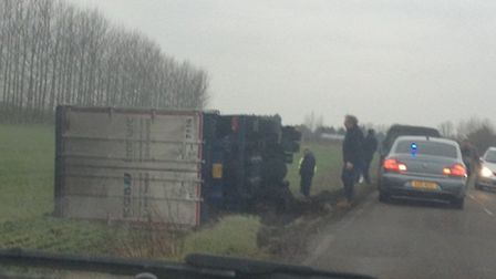 The lorry, which toppled onto its side in a field off Wimblington Road, Manea.