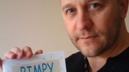 """Mark Perry holds a copy of """"Bimpy"""", which he worked on with his father"""