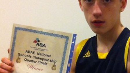 Ryan Davies shows off his certificate for winning his quarter-final bout.