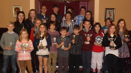 Members of Wisbech Swimming Club display their awards