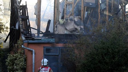 Suffolk Fire Services work on putting out a fire at a bungalow on Malting End in Wickhambrook on Wed