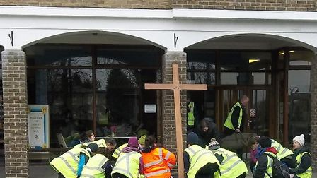 A group of people pray outside Trinity Methodist Church, Wisbech