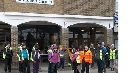 A group of people congregate outside Trinty Methodist Church, Wisbech