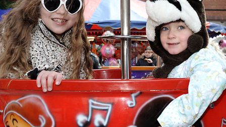 Easter Fun Day at Horsefair shopping centre, Wisbech, Madeleine and Ebony Hennells on the tea cup ri