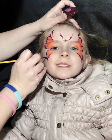 Easter Fun Day at Horsefair shopping centre, Wisbech, Shani Sharman having her face painted.