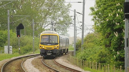 A First Capital Connect train heading to King's Lynn along the Fen Line after passing the Ely North