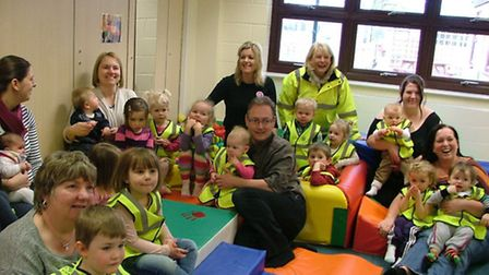 Children at Whittlesey and District childminding group wearing reflective vests provided by the Lion