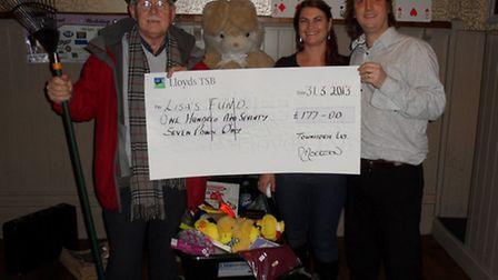 Pictured with landlord and landlady of the Townhouse is the first prize winner John Cruickshank.