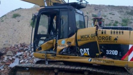 A damaged digger at a Mick George operated quarry