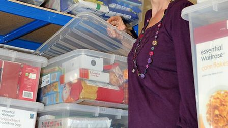 Volunteer Alison Bowles sorting out the dry package store.