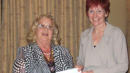 President Pauline Lancaster and Aly Anderson, of Mind in Cambridgeshire, receiving a cheque for £100