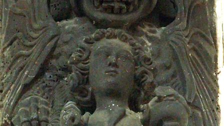 The carved demons at St Clement's Church