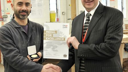 Diego Bernasconi recieves his award from principal of the college of West Anglia Isle Campus David P
