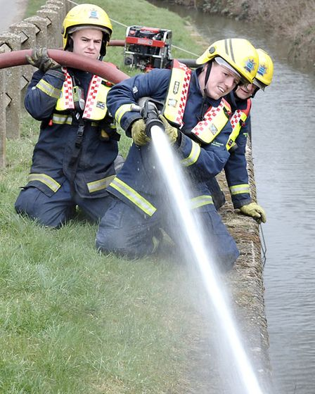 Whittlesey Mayor's charity duck race. Whittlesey Firefighters help move the flow of water.