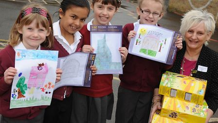 Budding painters from Gorefield Primary School in Wisbech collect their prizes from Harrison Murray