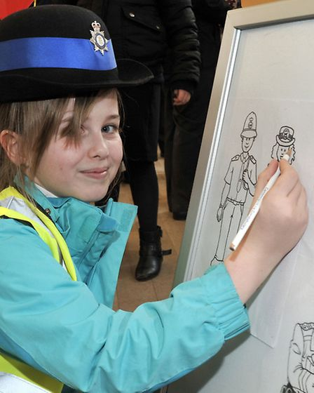 March Community Centre.Year 6 Careers Convention. Megan wearing the PCSO hat .