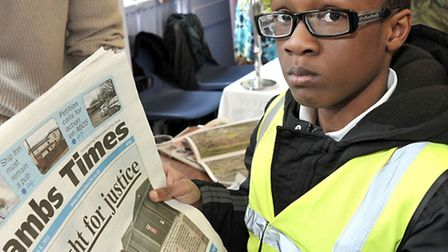 March Community Centre.Year 6 Careers Convention. Osaki reading the Cambs Times.