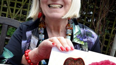Lucille Carter with the cards that she has painted.
