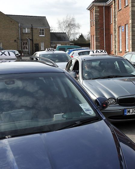Taxi drivers dropping of grant forms at Fenland Hall.