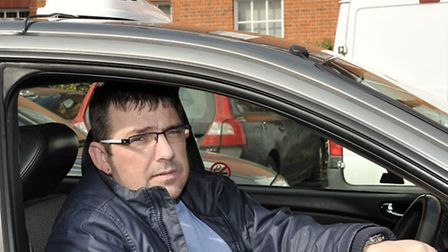 Taxi drivers dropping of grant forms at Fenland Hall. Taxi driver Steve Watson.