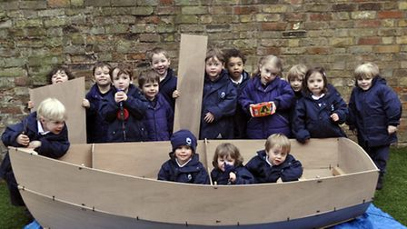 King's Ely Acremonet pupils with their boat