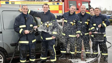March firefighters charity carwash at Tesco,