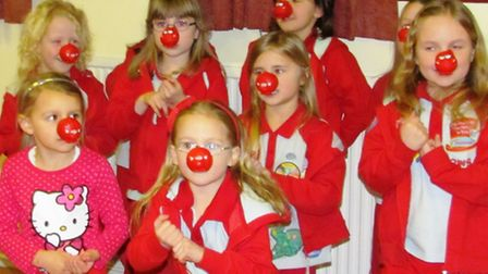 Manea's Rainbows pose wearing red noses for Comic Relief