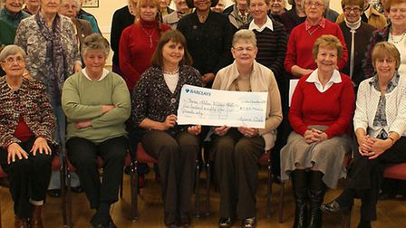 Cheque for £585.00 was presented to Sue Lowe from Three Holes Village Hall Committee for help after