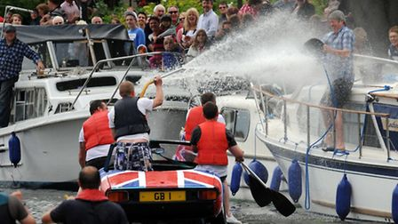 The crowds were drenched by this raft race team.