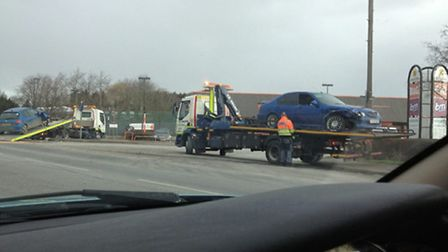A blue car is recovered from the scene of the crash