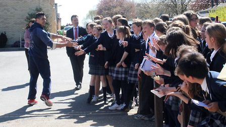 Louis Smith greets King's Ely Junior pupils