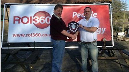 Club President Barry Feetham presenting the winning trophy to Vets captain Rob Whyman