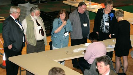 Fred Brown, far left, looks on as counting in the Littleport ward takes place