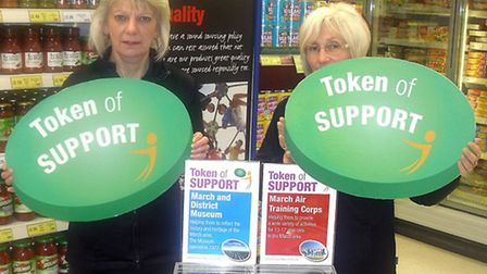 Deputy store manager Sue Bird and colleague Avril Garner urge you to make your token of support coun