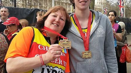 Lydia and Ricky with their medals after completing the London Marathon