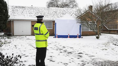A Police officer stands outside the home of murder victim Una Crown. Picture: Ian Burt