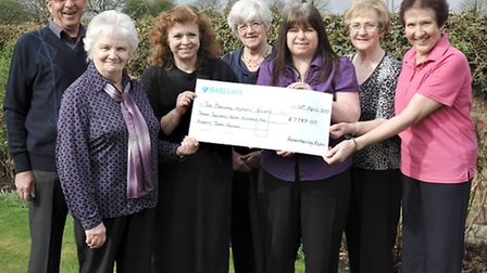Cheque presentation for Dylan's Fund. Left: Tom Hockley, Esther Cain and Jackie Luland from the Nati