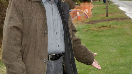 Alan Palmer next to where the trees have been cut down on Upwell road March.