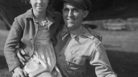 Major Jesse Davis of the 78th Fighter Group is photographed here with a local Duxford girl. The US a